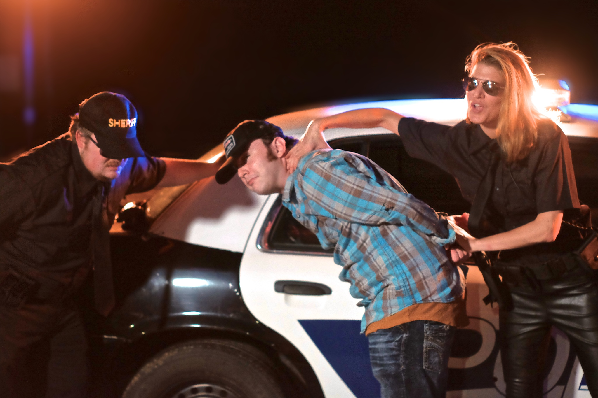 Police enjoying the arrest in a promo shot from the set of Nick Brennan's music video Buck Naked